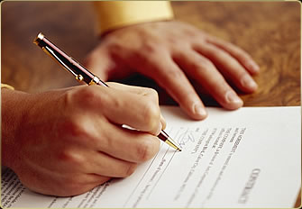 Signing a Mortgage Document